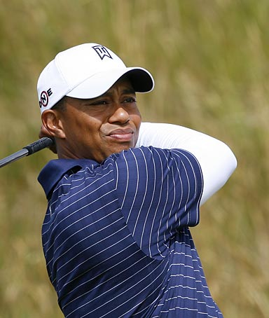 US golfer Tiger Woods tees off from the 13th tee box during a practice round on the course at Turnberry in Scotland.