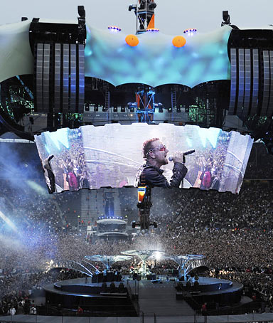 Bono, singer of Irish rock band U2, performs at the Olympic Stadium in Berlin, Germany.
