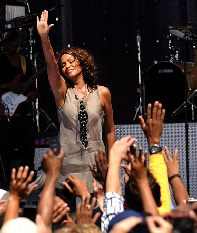 Singer Whitney Houston performs during a taping for