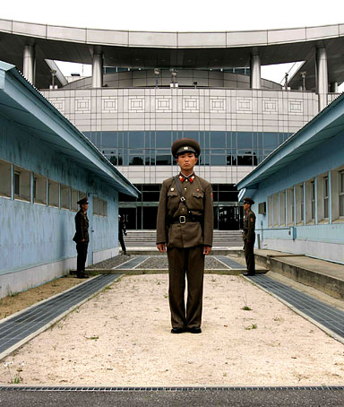 A North Korean soldier stands guard on the north side of the DMZ line separating North and South Korea