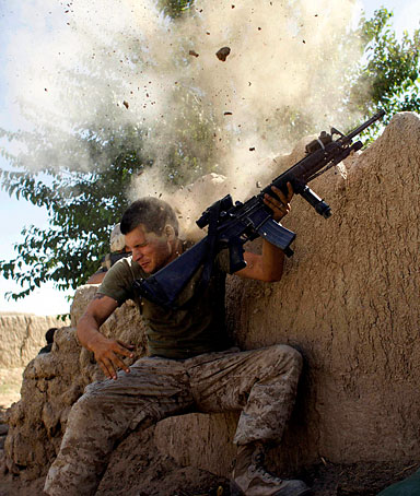 Sgt. William Olas Bee, a U.S. Marine from the 24th Marine Expeditionary Unit, has a close call after Taliban fighters opened fire near Garmser in Helmand