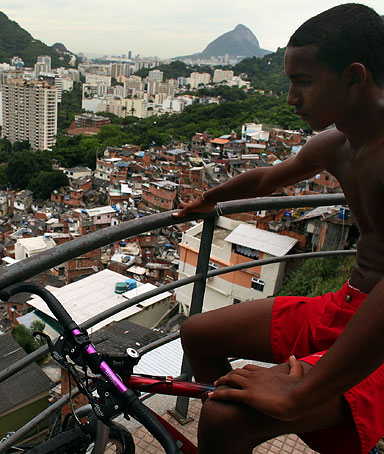 A teenager looks out at downtown Rio from recently 'pacified' Santa Marta, one of Rio's oldest slums