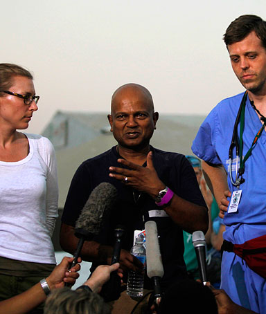 Doctors from The University of Miami hospital speak during a news conference at the international airport in Port-au-Prince February 8, 2010