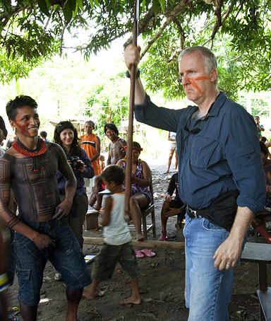 Director James Cameron receives a gift from tribe leaders that had gathered to discuss strategies to fight the construction of the Belo Monte hydroelectric dam project on the Xingu River in Volta Grande do Xingu, Brazil on March 29, 2010