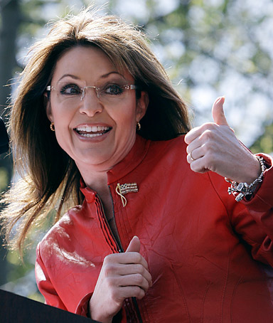 Sarah Palin flashes a thumbs up towards her husband Todd as she begins to address a crowd during a stop of the Tea Party Express on Boston Common in Boston,