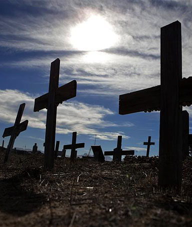 Crosses fill a graveyard in Cape Town's Khayelitsha township February 27, 2010. Many of those buried in the cemetery died from AIDS or related complications such as tuberculosis (TB)