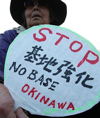 Protesters stage a rally with placards reading 'No Base Okinawa' in Tokyo on April 25, 2010