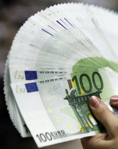 An employee counts Euro notes at the Bank of Taiwan head office