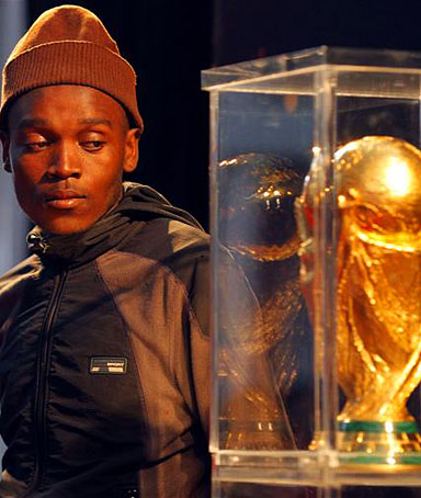 A soccer fan looks at the FIFA Soccer World Cup Trophy in Khayelitsha township near Cape Town, May 7, 2010.
