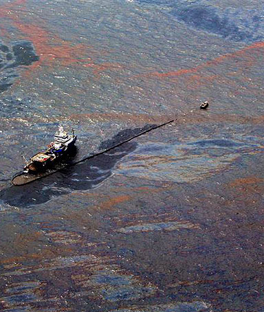 Oil floats on the surface of the Gulf of Mexico around a work boat at the site of the Deepwater Horizon oil spill in the Gulf of Mexico June 2, 2010.
