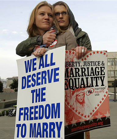 Same-sex couple Elizabeth Chase (L) and Kate Baldridge stand outside the federal courthouse in San Francisco, California January 11, 2010.