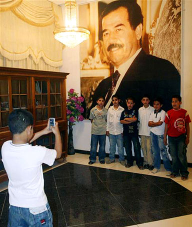 School children pose for a group picture during their visit to the mausoleum of Iraq's late former president Saddam Hussein on the anniversary of his birthday in al-Awja village near Tikrit, 175 km (109 miles) north of Baghdad April 28, 2009