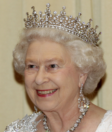Britain's Queen Elizabeth smiles as she greets guests in the receiving line before a state dinner in Toronto July 5, 2010.