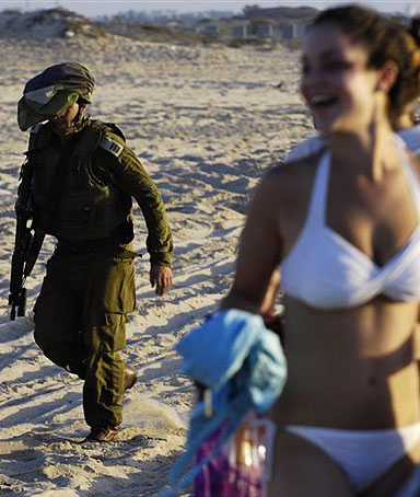 Israeli soldiers patrol along the beach after mortar bombs fired by Palestinian militants in Gaza landed near Kibbutz Zikim, just outside the northern Gaza Strip August 24, 2009.