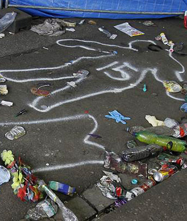 Positions of victims 14 and 15 of a deadly stampede are marked on the street between two tunnels in Duisburg July 25, 2010.