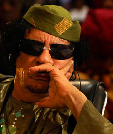 Libyan leader Muammar Gaddafi attends the opening of the African Union summit at the Commonwealth Resort in Munyonyo, near Uganda's capital Kampala, July 25, 2010.