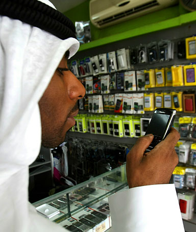 A man looks at a BlackBerry mobile phone in a store in Dubai on August 01, 2010.