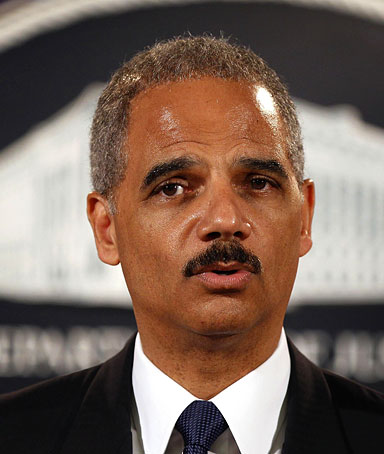 U.S. Attorney General Eric Holder announces charges of terrorism violations against 14 people for providing resources to the foreign organization al-Shabaab at the U.S. Justice Department in Washington, August 5, 2010.