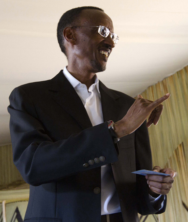 Rwandan president Paul Kagame shows his inked finger after casting his vote at the Echo Rugangan School in central Kigali, Rwanda, Monday, Aug. 9, 2010.