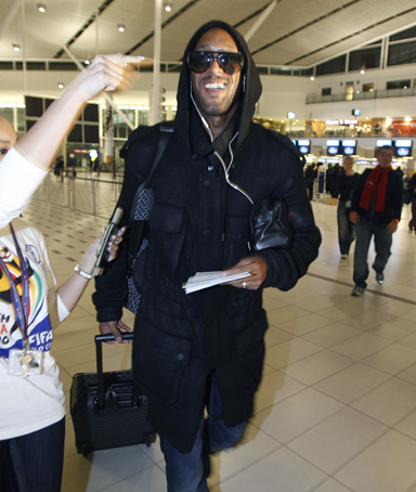 French soccer player Nicolas Anelka walks to the gate as he boards a flight to London at the international airport in Cape Town, June 20, 2010