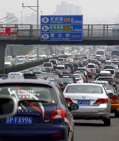 Cars can be seen in a traffic jam along a main road in central Beijing August 20, 2010