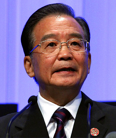 Chinese Premier Wen Jiabao speaks during the opening plenary session of the World Economic Forum at the Meijiang Convention Centre in the northern Chinese city of Tianjin September 13, 2010.