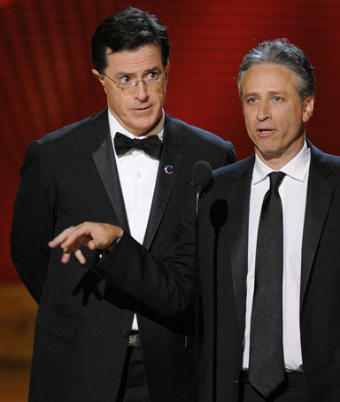 In this Sept. 21, 2008 file photo, Stephen Colbert, left, and Jon Stewart make an award presentation at the 60th Primetime Emmy Awards in Los Angeles.