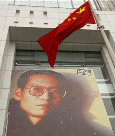 A protester holds a poster of one of China's best known dissidents Liu Xiaobo, outside the Chinese liaison office, during a protest in Hong Kong urging for Liu's release January 25, 2010.