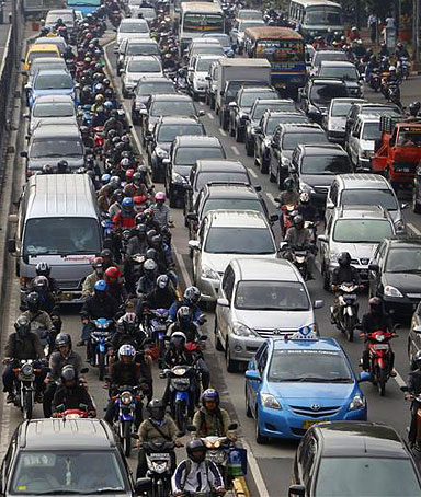 Vehicles and motorcycles are seen during rush hour in Indonesia's capital of Jakarta June 7, 2010.