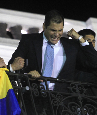 Ecuadorean President Rafael Correa speaks from the balcony of the Carondolet Palace as hundreds of supporters gathered to greet him in Quito September 30, 2010.