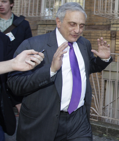 New York Republican gubernatorial candidate Carl Paladino gestures after a reporter's question about prior controversial remarks while campaigning in the Borough Park and Williamsburg sections of the Brooklyn borough of New York, Sunday, Oct. 10, 2010.