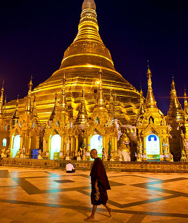 A monk walks near Shwedagon Pagoda in Rangoon, Burma.
