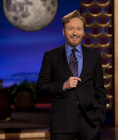 Comedian Conan O'Brien is shown on stage during the premiere of his new late night talk show on TBS 'Conan'at the Warner Bros. Studios in Burbank, California November 8