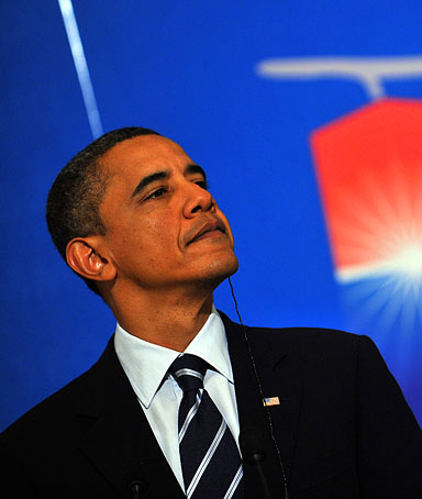 US President Barack Obama listens to South Korea's President Lee Myung-Bak (not pictured) during a joint press conference at the presidential Blue House in Seoul on November 11, 2010