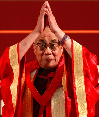 Tibetan spiritual leader the Dalai Lama greets people as he arrives to receive an honorary Doctor of Letters degree from the Jamia Millia Islamia University in New Delhi, India, Tuesday, Nov. 23, 2010