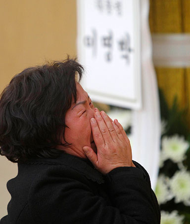A relative of a soldier killed by artillery shells fired by North Korea on Yeonpyeong Island, cries at a memorial altar in Seongnam, near Seoul November 24, 2010