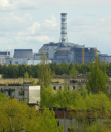 n this May 10, 2007 file photo a general view of empty houses in the town of Pripyat and the closed Chernobyl nuclear power plant in the background