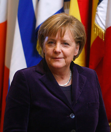 German Chancellor Angela Merkel leaves an EU Summit at the EU Council building in Brussels, Thursday, Dec.16, 2010