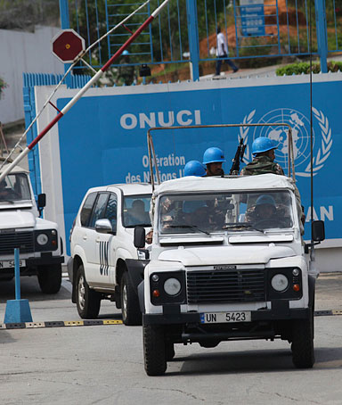UN troops exit the UN headquarters that was attacked Friday by gunmen, in Abidjan, Ivory Coast, Sunday, Dec.19, 2010, on a routine patrol