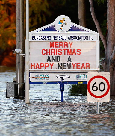Signboards are partially submerged by floodwater in Bundaberg, Queensland December 31, 2010