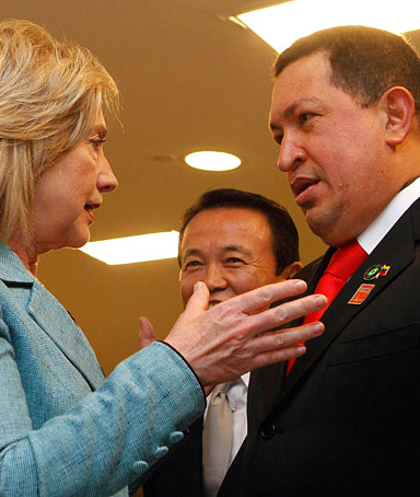 U.S. Secretary of State Hillary Clinton talks with Venezuela's President Hugo Chavez during a reception for the newly inaugurated Brazilian President Dilma Rousseff at Planalto Palace in Brasilia January 1, 2011