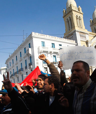 Protestors shoot slogans against former Tunisian President Zine El Abidine Ben Ali in the center of Tunis, Monday, Jan. 17. 2011