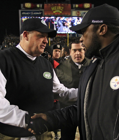 New York Jets head coach Rex Ryan, left, congratulates Pittsburgh Steelers head coach Mike Tomlin after the Steelers beat the Jets 24-19 in the AFC Championship NFL football game in Pittsburgh, Sunday, Jan. 23, 2011