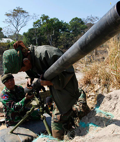 Cambodian soldiers prepare their weapons as they take position near Preah Vihear temple along the border with Thailand February 6, 2011