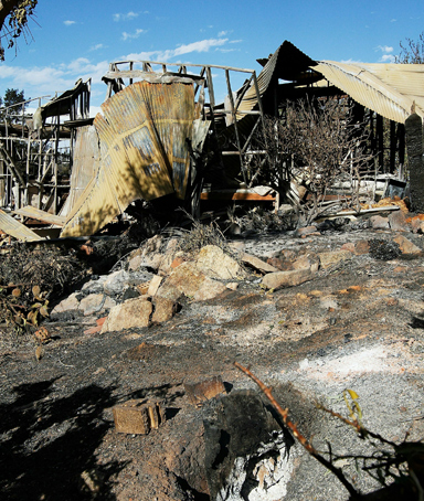A home destroyed by a bush fire is seen on February 7, 2011 in Perth, Australia