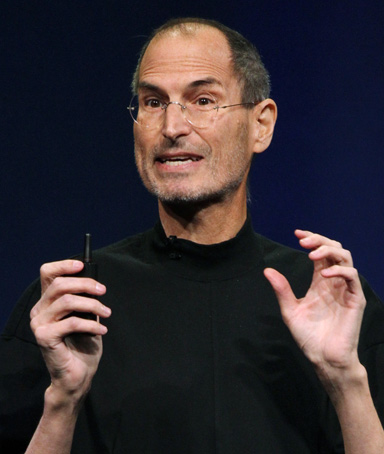 Apple Inc. CEO Steve Jobs introduces the iPad 2 on stage during an Apple event in San Francisco, California March 2, 2011