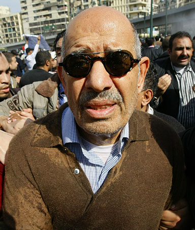 Egyptian Leading dissident and former UN nuclear watchdog Chief Mohamed ElBaradei is surround by fellow demonstrators during protests in central Cairo on January 28, 2011 calling for the ouster of President Hosni Mubarak.