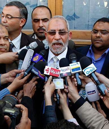 Muslim Brotherhood leader Mohammed Badie speaks to the media after casting his vote for a referendum at a polling station in Cairo March 19, 2011.