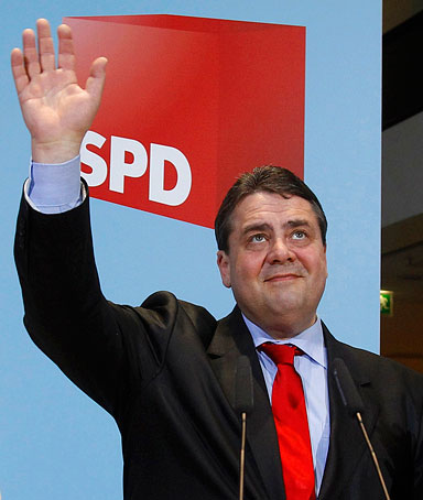 Germany's SPD leader Sigmar Gabriel and SPD secretary general Andrea Nahles (L) react after hearing first exit polls for the Baden-Wuerttemberg and Rhineland-Palatinate state elections at the party headquarters in Berlin March 27, 2011