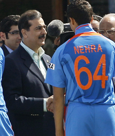Pakistan Prime Minister Yousuf Gilani, center, shakes hands with India players Yuvraj Singh, foreground left, and Ashish Nehra, ahead of the Cricket World Cup semifinal match between India and Pakistan